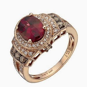 Le vian stawberry gold and ring with a red stone centerpiece