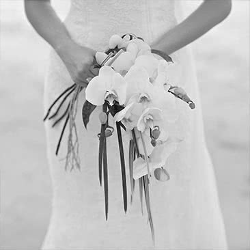 Bride in a white dress holding a bouquet of flowers