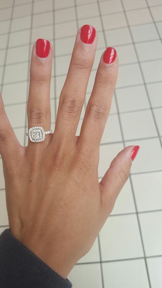 A ring shot with a Neil Lane Halo Cushion Cut