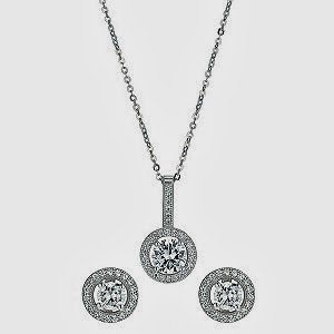 Silver pendant and stud earrings set with zircona stones.