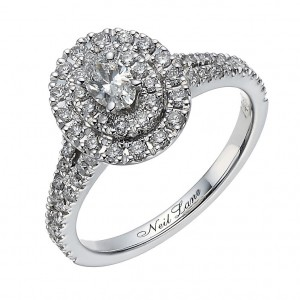Diamond studded wedding ring with 2 rings of stones around a central stone