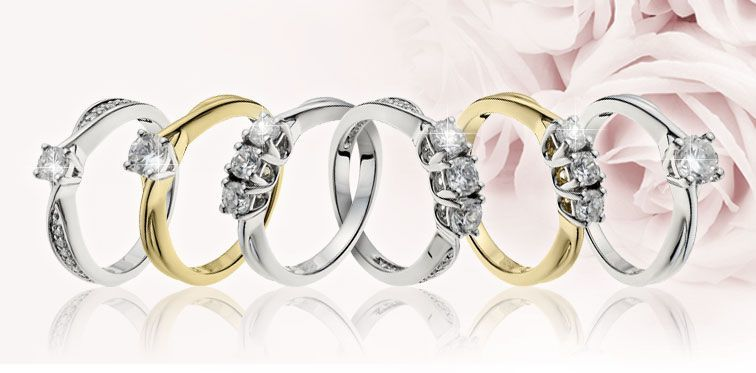 Interlinking diamond rings available at Ernest Jones